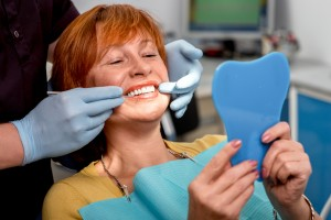 image of woman getting dentures